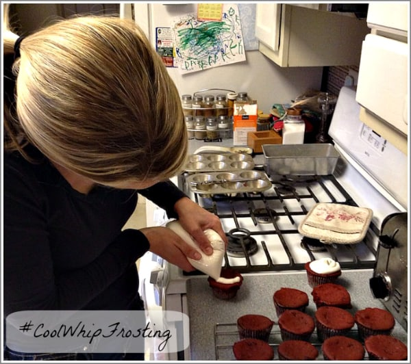 decorating red velvet cupcakes with cool whip frosting