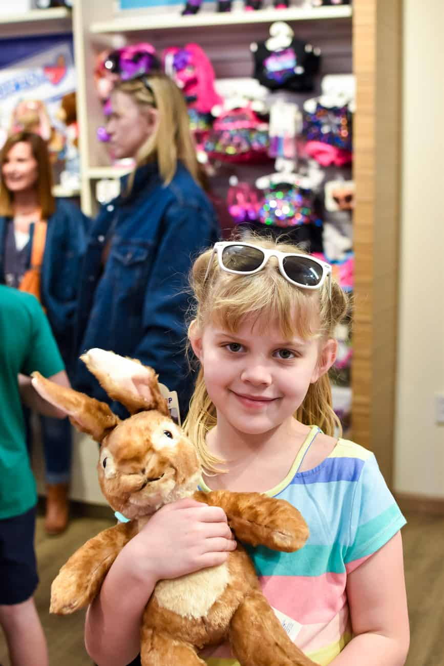 Girl holding Peter Rabbit at Build a Bear workshop