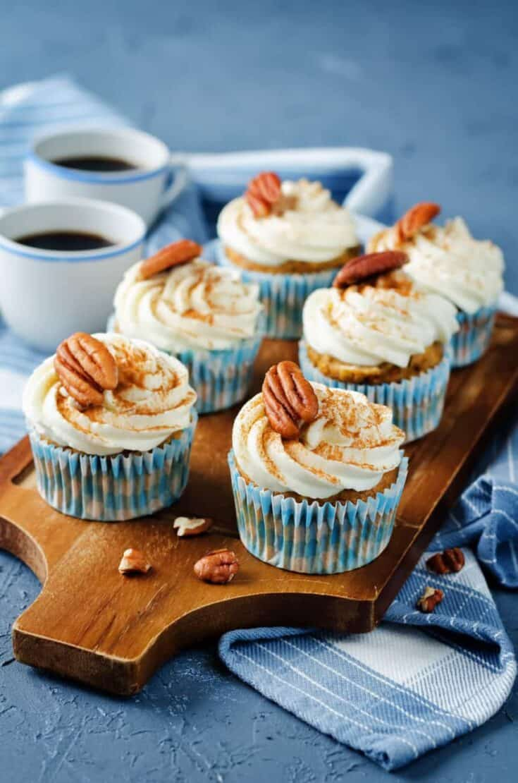 The best carrot cake cupcakes recipe in the world, with the most delicious cream cheese buttercream frosting! #carrotcake #cupcakes #carrotcakerecipes