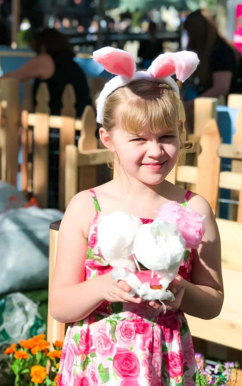 girl holding a cotton candy doughnut at the Peter rabbit premiere