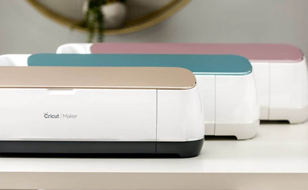 3 Cricut Maker machines in champagne, blue and pink