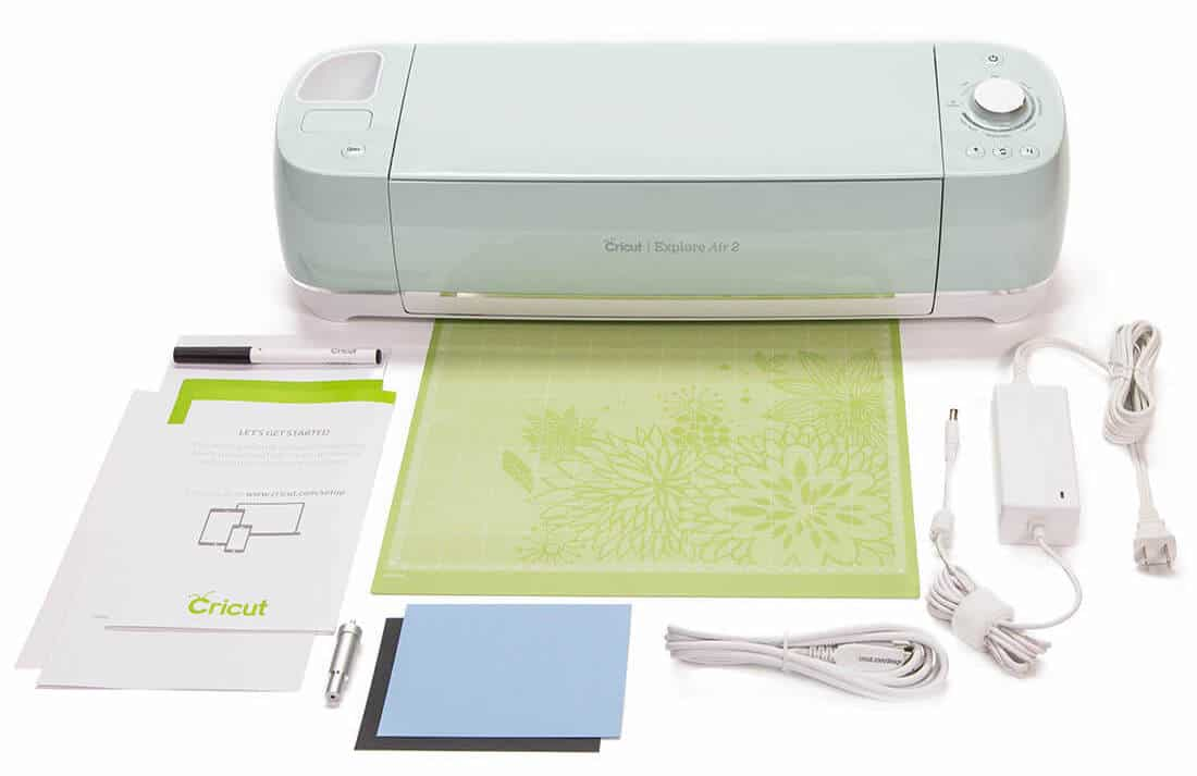 Mint green Cricut Explore Air 2, cutting mat, instructions, cords and all items that come with it