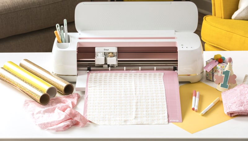 Fabric, vinyl, pens and other materials being used with a Cricut Maker