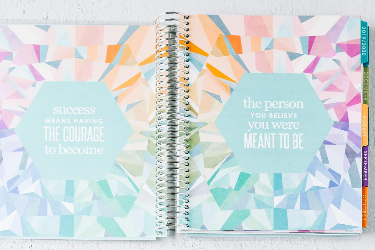 Open spiral bound note book with quotes on two pages
