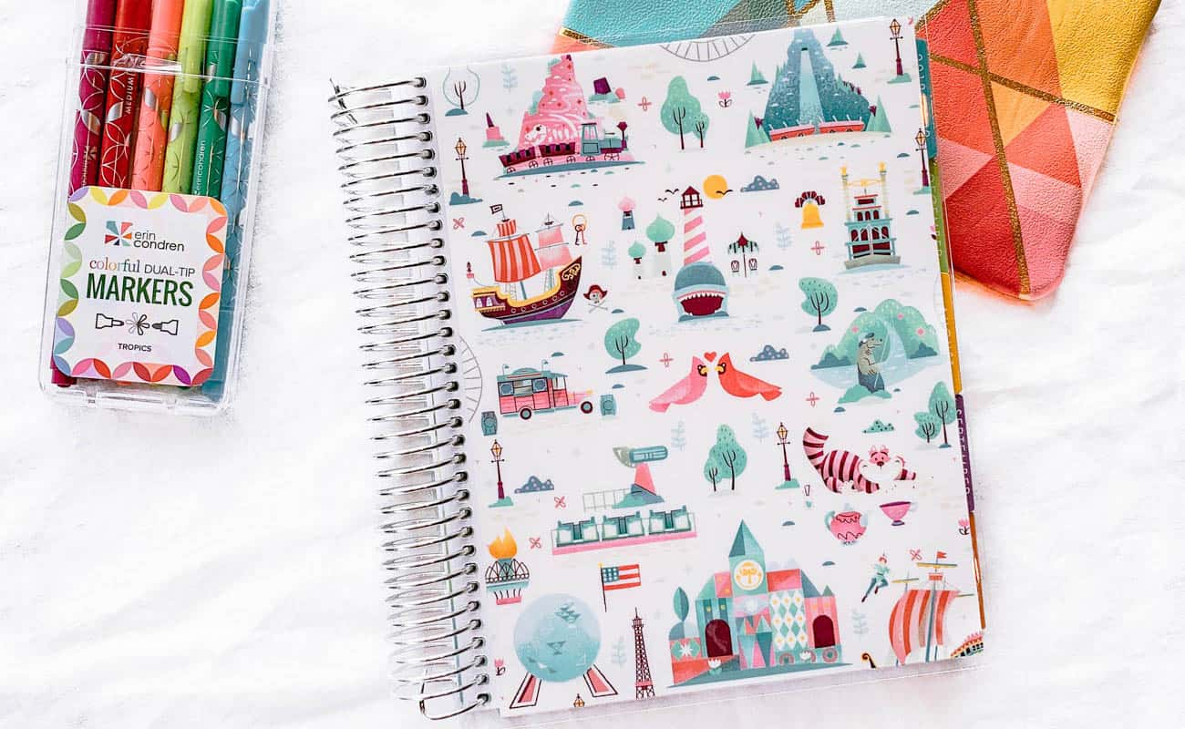 Front cover of spiral bound notebook with pack of pens and pencil pouch