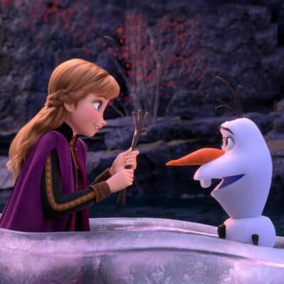 Frozen 2 still with Anna and Olaf in ice canoe