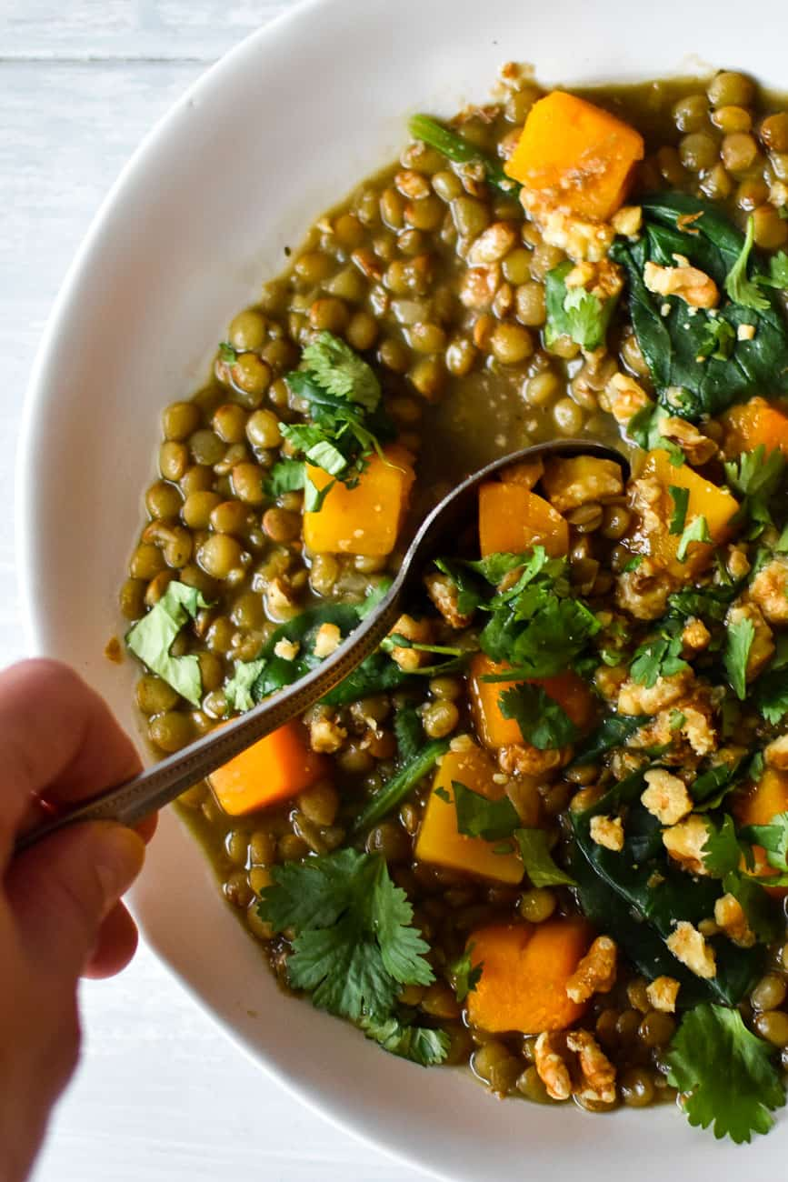 spoon in butternut squash lentil soup