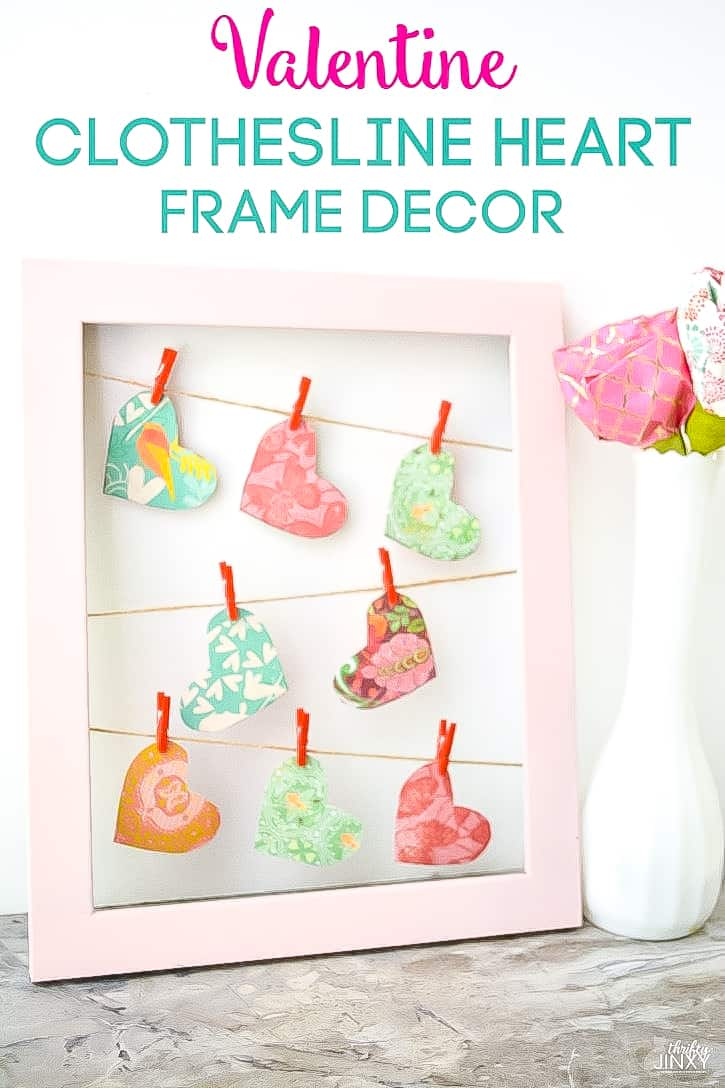 frame with hanging hearts decoration
