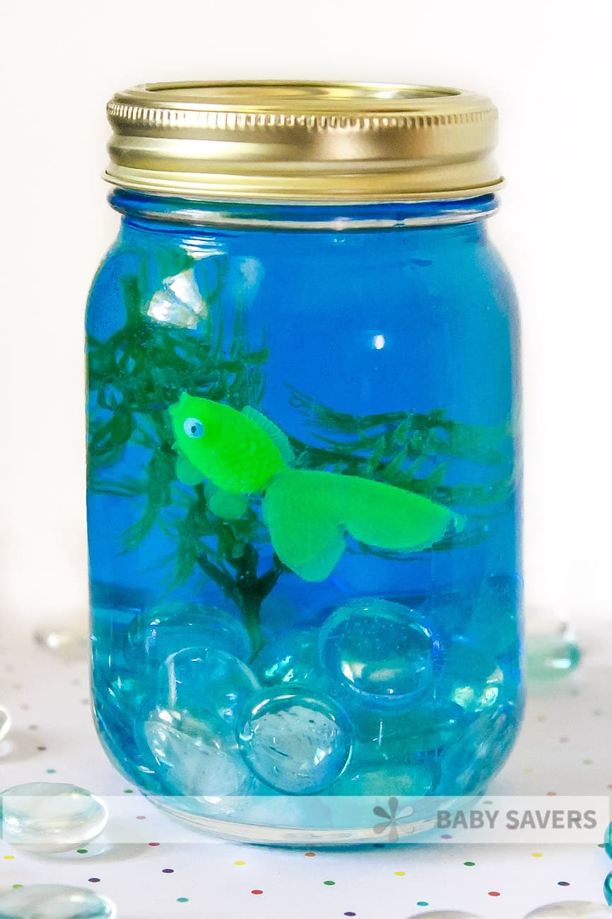 green fish in mason jar aquarium