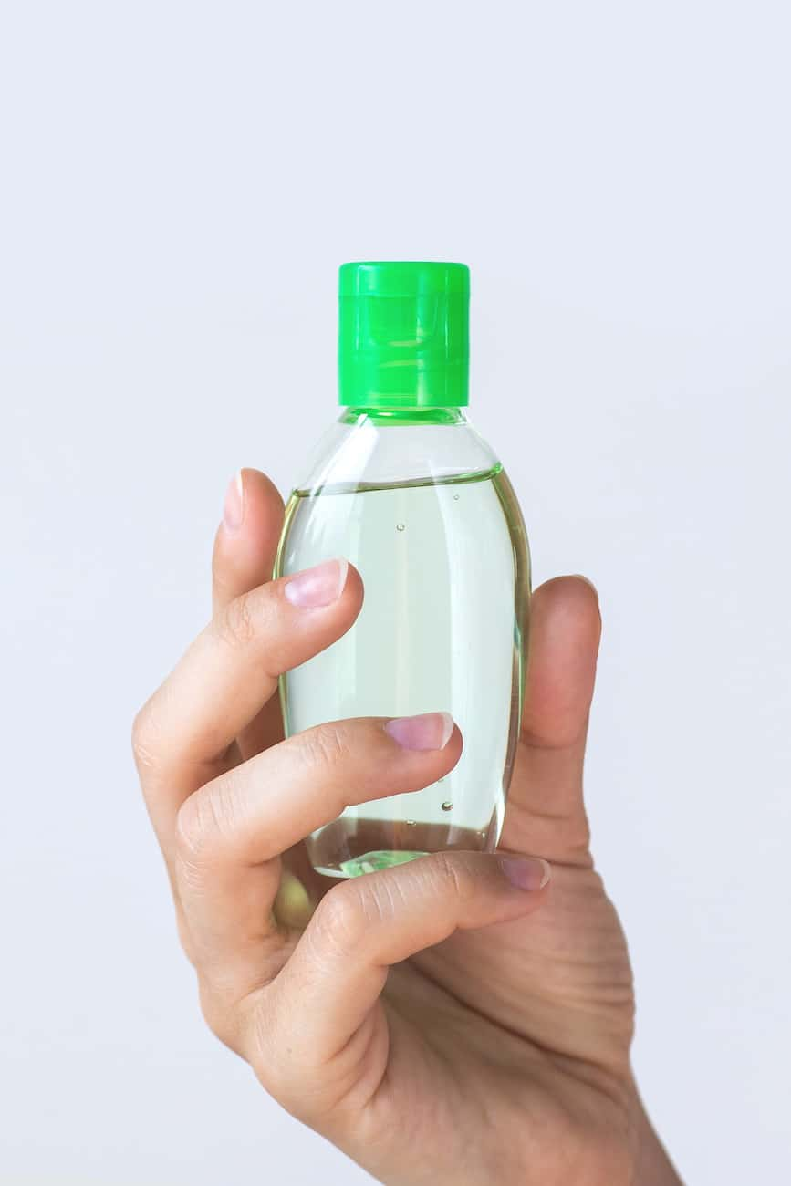 homemade hand sanitizer in green bottle