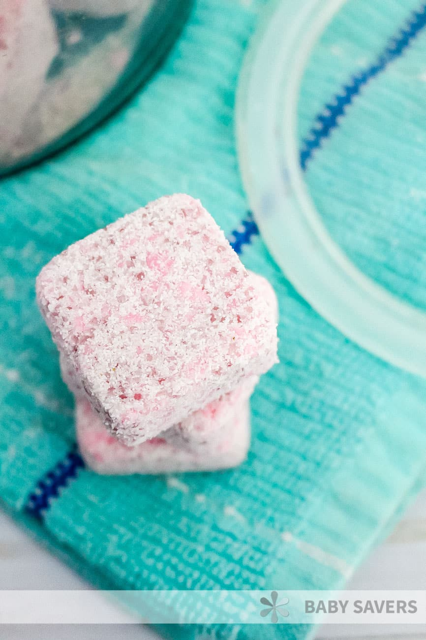 stacked pink squares of homemade laundry soap to use for washing clothes