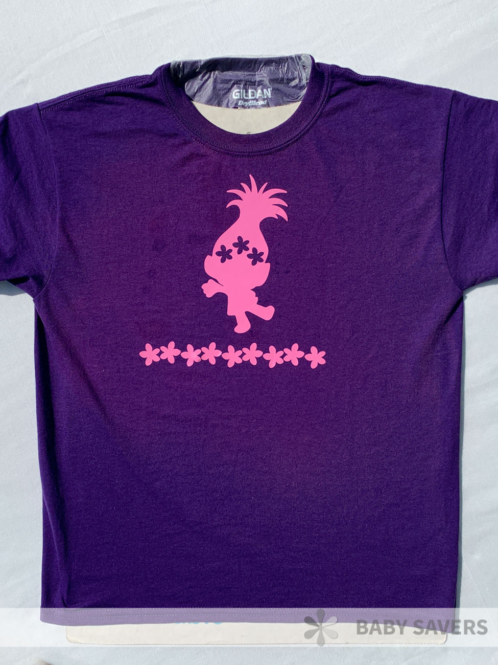 purple shirt with pink trolls sticker on there and reverse dye around the stickers