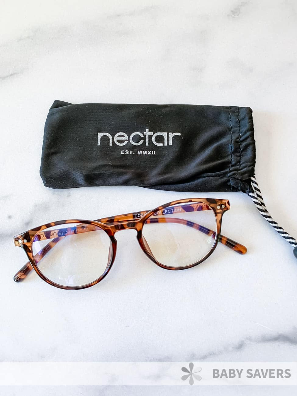 round tortoiseshell glasses with microfiber pouch