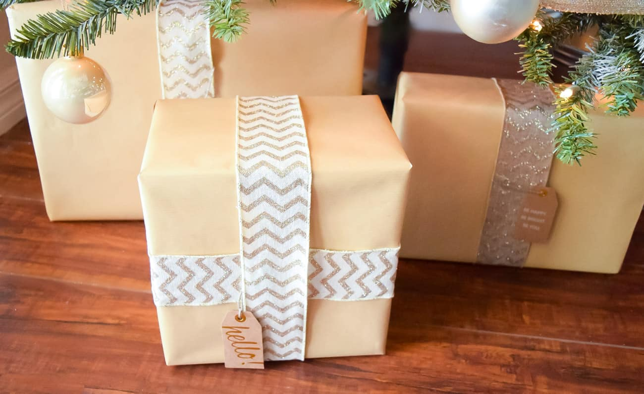 wrapped presents to match gold and white Christmas tree