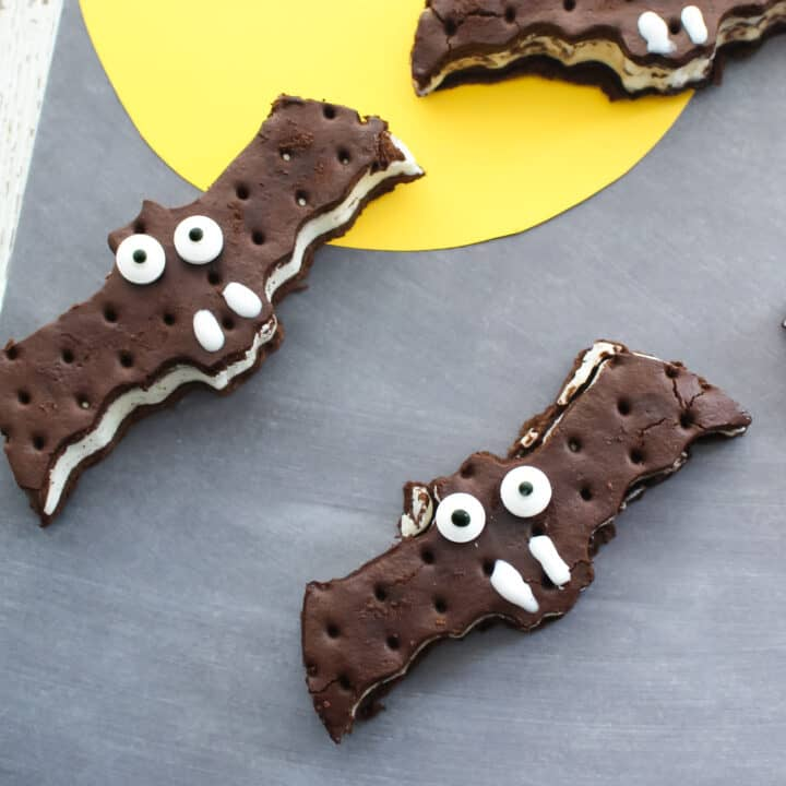 easy halloween dessert. Bat ice cream sandwiches on grey background