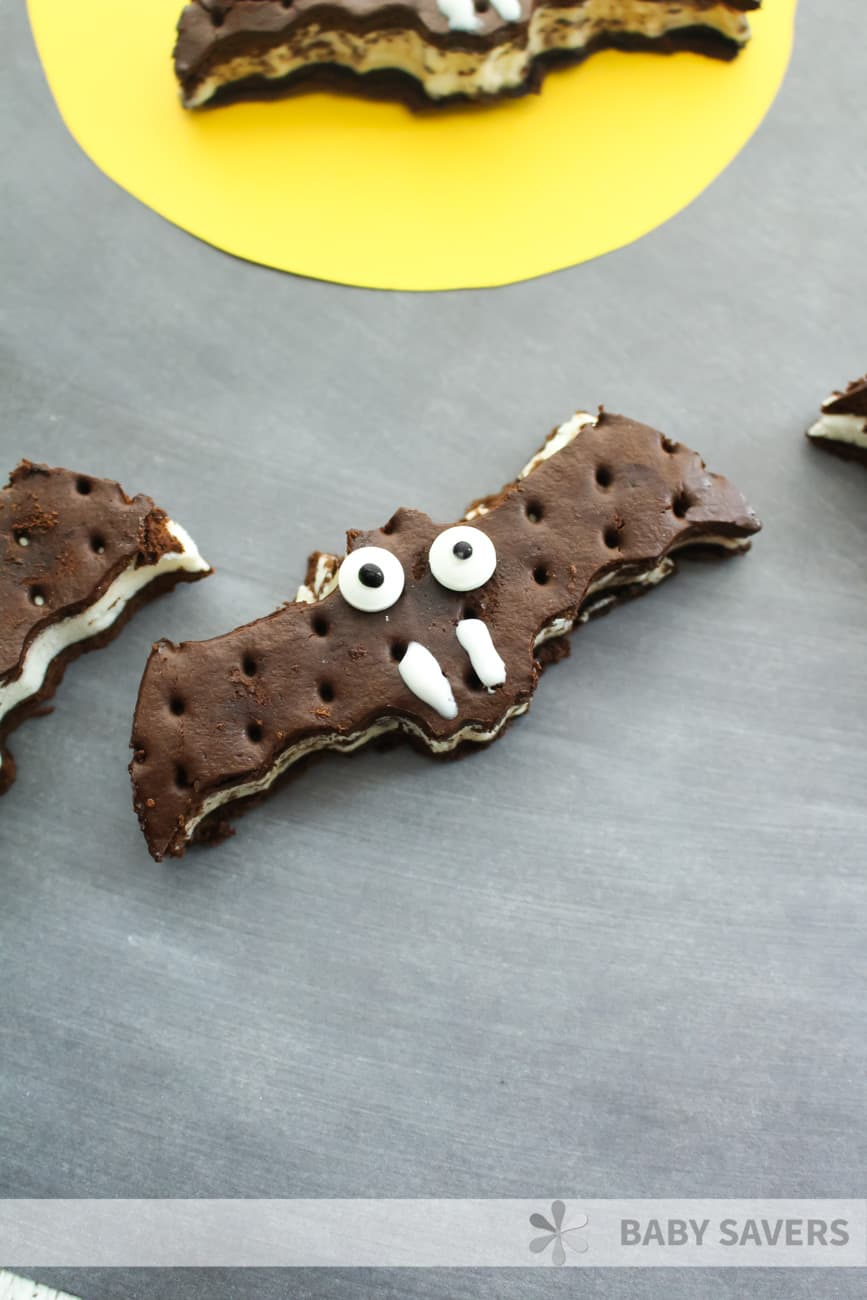 spooky bat shaped ice cream sandwiches decorated with eyes and fangs