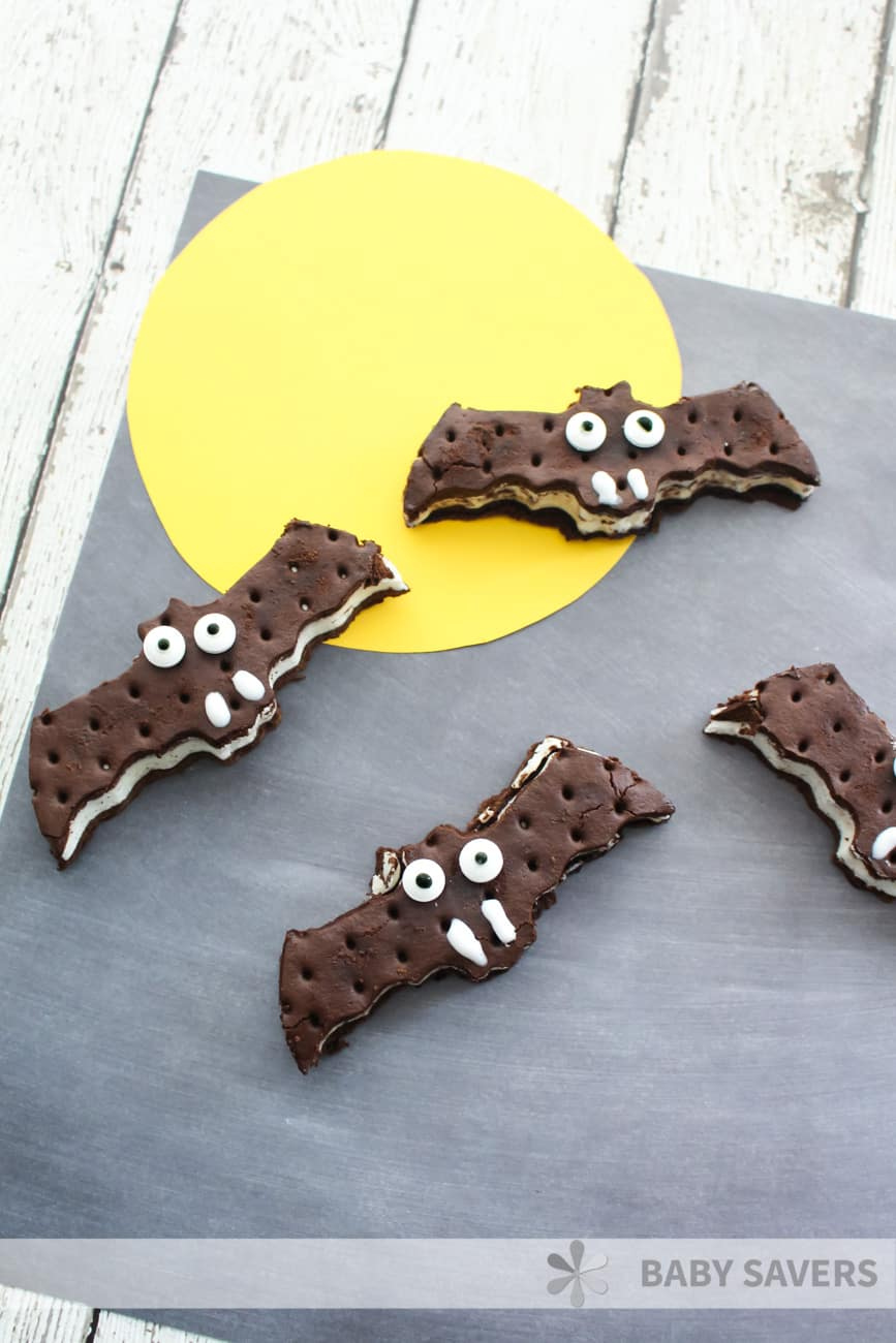 Easy halloween dessert - ice cream sandwiches cut into bat shapes and decorated with white icing