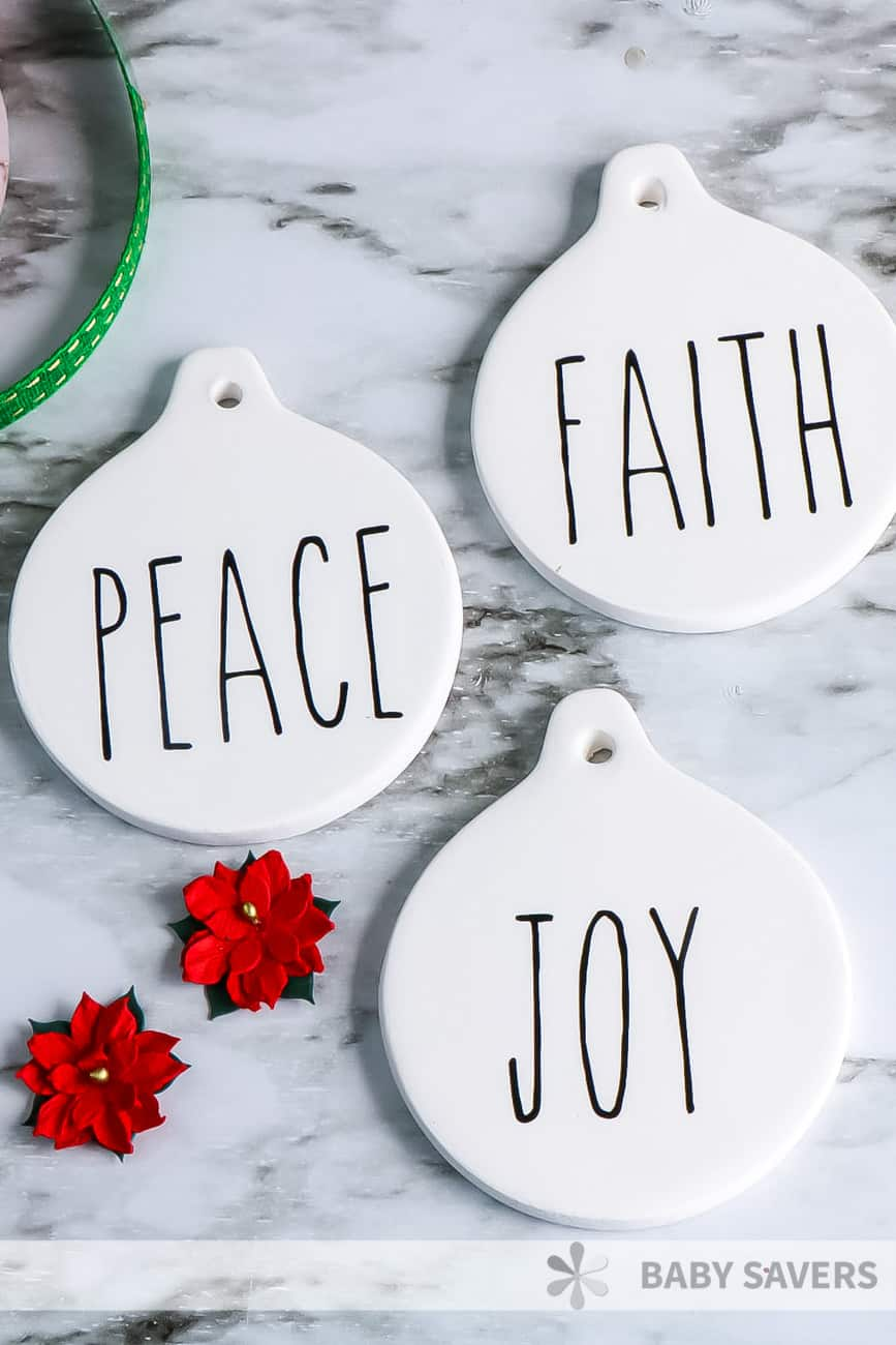 Rae Dunn Inspired Christmas ornaments with Peace, Faith, Joy in vinyl on them
