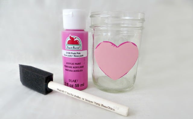 heart sticker on mason jar with acrylic paint and sponge paint brush
