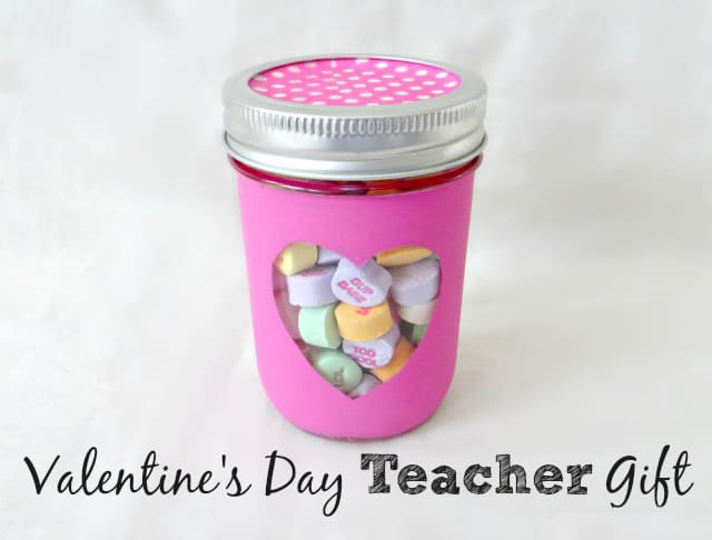 Teacher valentine gift idea: mason jar painted in pink with a heart and filled with candy conversation hearts