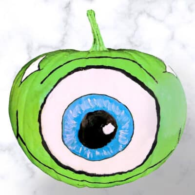 mike wazowski pumpkin on a marble background