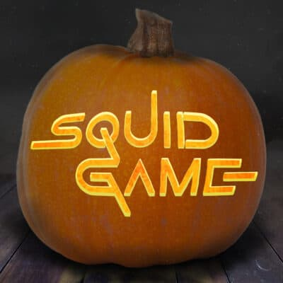 squid game pumpkin carving stencil pictured on a pumpkin with the logo for the series