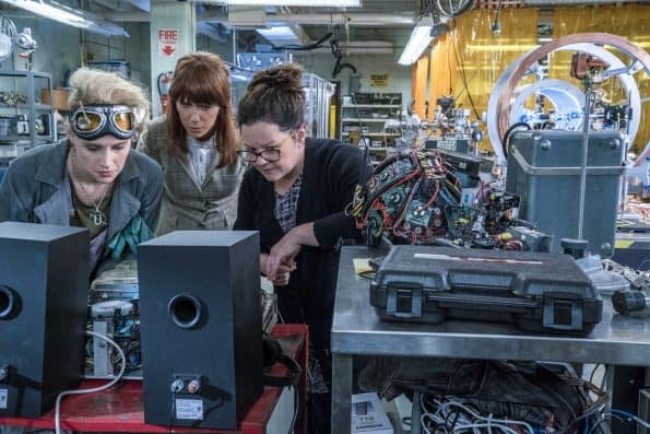 Erin (Kristen Wiig) comes to talk to Abby (Melissa McCarthy) and Holtzmann (Kate McKinnon) at the Paranormal Studies Lab at the Higgin's Institute in Columbia Pictures' GHOSTBUSTERS.