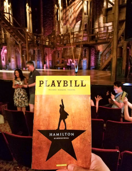 Hamilton playbill and stage for blogger bash